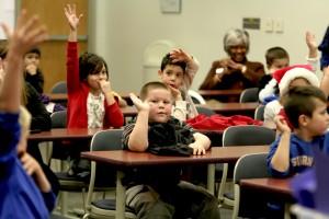 kids-raising-hands-at-lyons